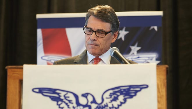 Rick Perry speaks to the crowd on Sept. 11, 2015, in St. Louis, as he announced he was dropping his presidential bid.