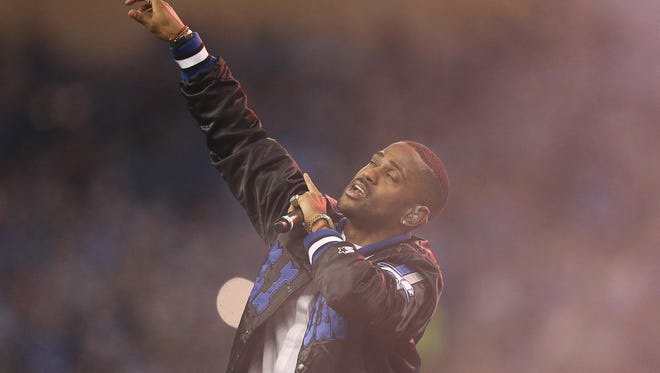 Big Sean performs during halftime on Thanksgiving Day last year at Ford Field in Detroit. He's scheduled to play at this year's Summer Jam.