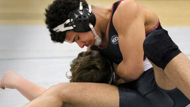 Wauwatosa's Lawrence Thomas battles West Allis Brady Mocco in a 220-pound match at Wauwatosa West on Jan. 25.