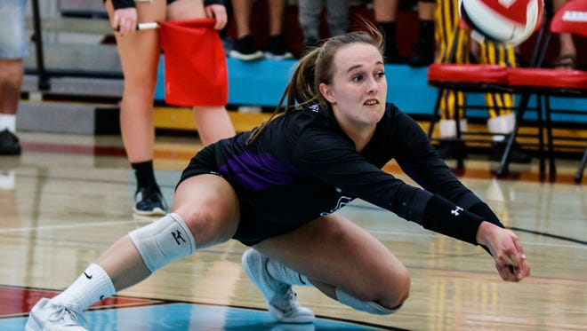 Oconomowoc senior Paige Jaeger (9) digs a serve during the match at Arrowhead on Tuesday, Sept. 19.