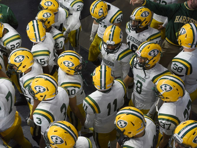 Farmington Harrison players wait in the tunnel of Ford