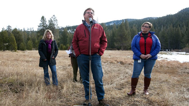 Grant Davis, director of the Dept. of Water Resources, center, discusses the results of the first snow survey of the season at the nearly snow barren Phillips Station snow course, Wednesday, Jan. 3, 2018, near Echo Summit, Calif. The snow survey showed the snowpack at this location at 1.3 inches of depth with a water content of .4 inches. California's water managers are saying it's too early yet for fears that the state is sliding back into its historic five-year drought. (AP Photo/Rich Pedroncelli)