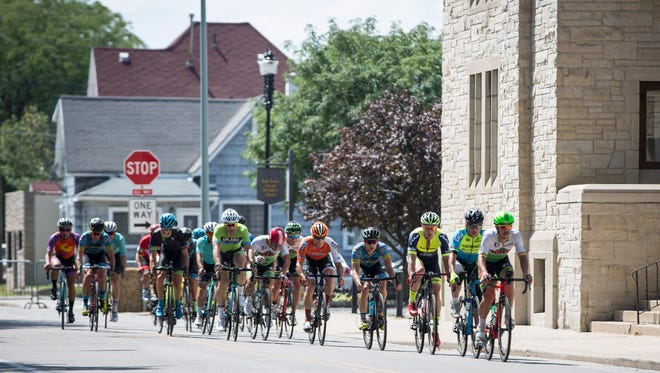 Hundreds of racers take part in the Muncie Grand Prix Criterium Race July 30, 2017, in downtown Muncie, as part of the Cardinal Greenway Bike Fest.