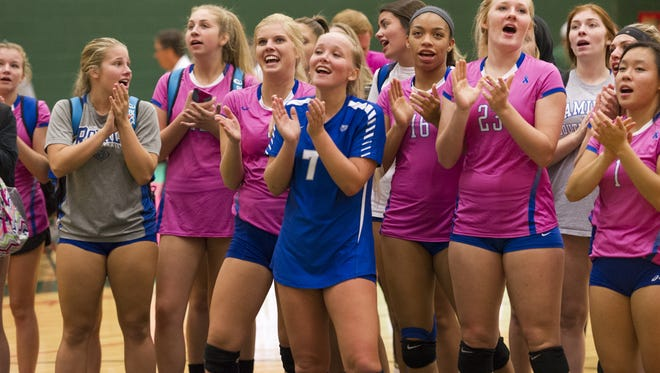 The Hamilton Southeastern players sing to their fans after winning against Lawrence North High School during varsity volleyball action Tuesday, August 23, 2016, at Lawrence North High School.