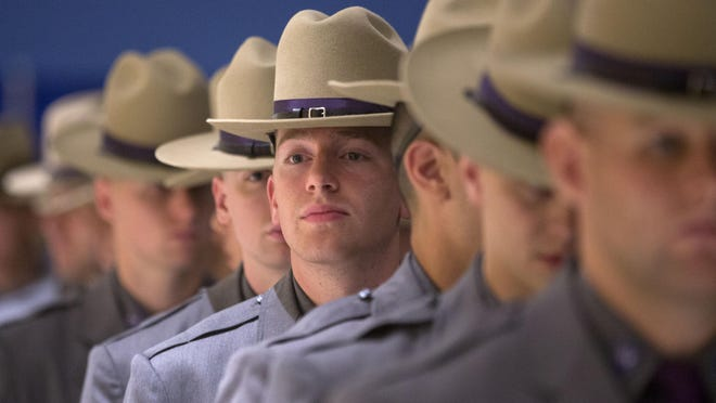 Graduating New York State Police troopers line up before a ceremony at the Empire State Plaza Convention Center on Thursday, Sept. 3, 2015, in Albany, N.Y.