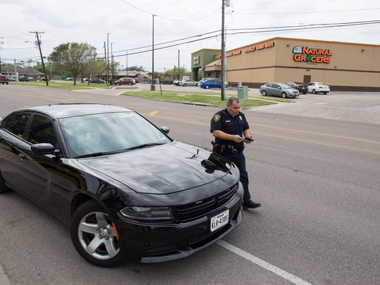 Corpus Christi police Senior Officer Gilbert Casas in the departments new stealth car pulls a drive over for using their cellphones along Doddridge Street on Thursday, March 8, 2018.
