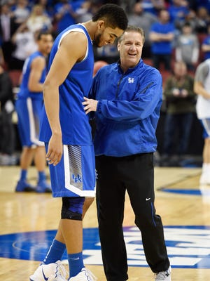 Mar 18, 2015; Louisville, KY, USA; Kentucky Wildcats forward Karl-Anthony Towns (12) and Kentucky Wildcats head coach John Calipari talk during practice before the second round of the 2015 NCAA Tournament at KFC Yum! Center. Mandatory Credit: Jamie Rhodes-USA TODAY Sports