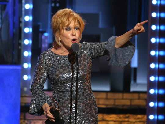 Bette Midler accepts the award for best performance