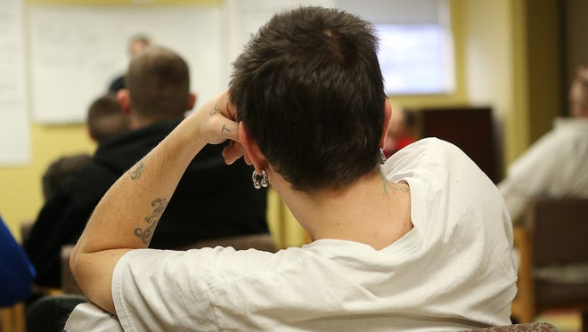 A man listens in a class at the Grateful Life Center in Erlanger, Kentucky .  The Center is an in-patient rehabilitation center for men recovering from addiction.