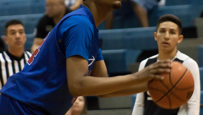 Las Cruces High's RJ Brown prepares for a free throw during Friday's team summer camp game against Oñate at LCHS. The Knights won 42-42 and the 2nd Annual Bulldawgs Team Camp continues through Saturday..