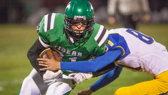 Yorktown's Cole Barr is taken down by the Greenfield Central defense during their homecoming game on Friday night. Yorktown lost the game 14-13.