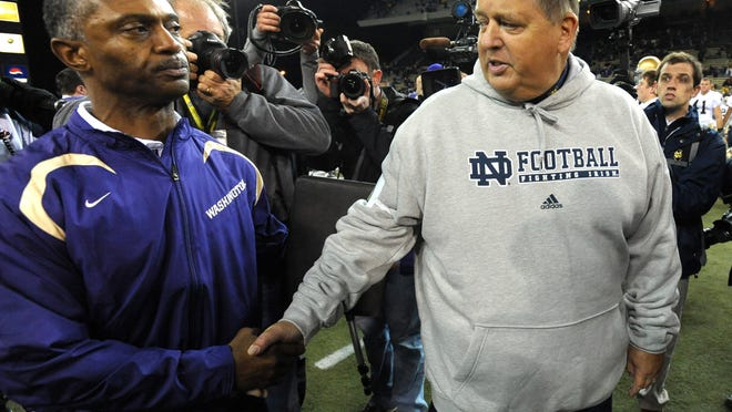 Oct. 25, 2008; Seattle, WA, USA; Washington Huskies head coach Tyrone Willingham and Notre Dame Fighting Irish head coach Charlie Weis shake hands after Notre Dame defeated Washington 33-7 at Husky Stadium. Mandatory Credit: Matt Cashore-USA TODAY Sports