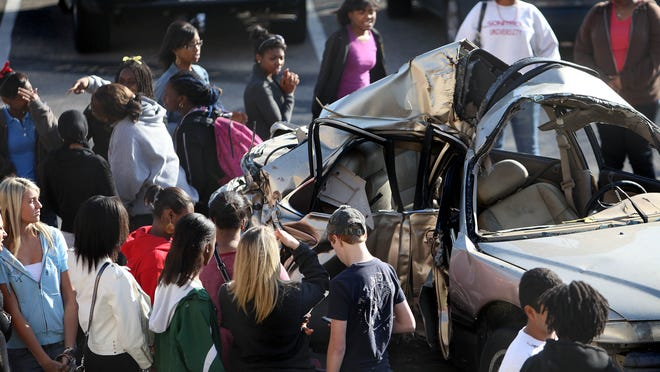 Real-life testimonials of the impact of underage drinking and drug use resonate with teenagers, experts say. Here, in 2011, Leon High School students look a mangled car in which Meagan Napier and Lisa Dickson were killed. Former Leon student Eric Smallridge, who was the drunk driver, was sentenced to 22 years in prison for the two deaths. He spoke and Meagan's mother spoke to the students at an event that day.
