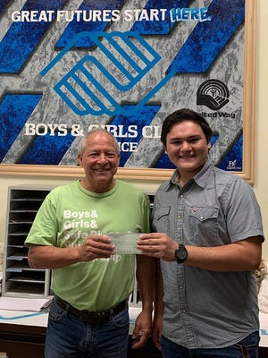On behalf of the Boys & Girls Club of Alice, Rick Del Bosque, executive director,  presented Blaze Benavides with a scholarship for his venture to James Madison University in Virginia.