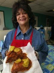 Prince's Hot Chicken Shack owner Andre Prince Jeffries holds some of her well-known spicy chicken.