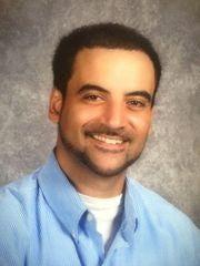 City Council Member Adam Hussain