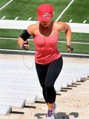 Tyla Hudspeth trains for the 2012 Boston Marathon by running stadium steps at Cajun Field.