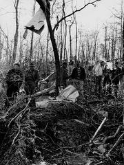 People inspect the plane crash site on March 6, 1963,