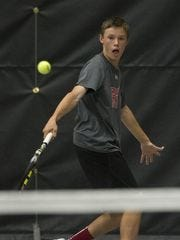 Wausau East's Sawyer Schlindwein returns a shot during the Wisconsin Valley Conference boys tennis meet last spring.