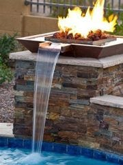 Fire features are a popular addition to a backyard pool.
