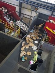 In this photo from November, cardboard is separated out from other recyclable materials on the conveyor belt in the recycling stream at the Penn Waste recycling facility in Manchester Township.