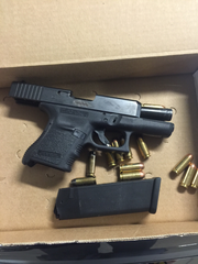 A loaded Glock 10mm handgun police recovered in a search warrant of Davis's car.