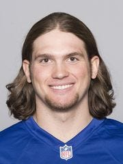 This is a 2015 photo of Cole Farrand of the New York Giants NFL football team. Ferrand helped rescue a man trapped on the roof of a burning home Monday.
