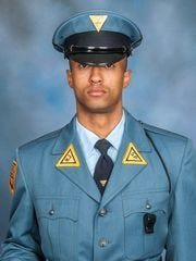Trooper Frankie Williams was killed in a head-on collision on Route 55 in Millville in December. His widow received his posthumous master's degree from Rutgers-Camden Wednesday.