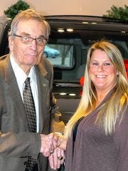 Ed Pobur sold Cadillacs for 50 years. He's shown here with Elise Muntian, customer advocacy manager at Cadillac of Novi.