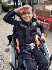 Piero Arroyo salutes his fellow officers as he was made an honorary deputy for a day. The Make-A-Wish patient from Ecuador was able to live his dream of being in law enforcement as he joined officers in Mississippi on Wednesday.