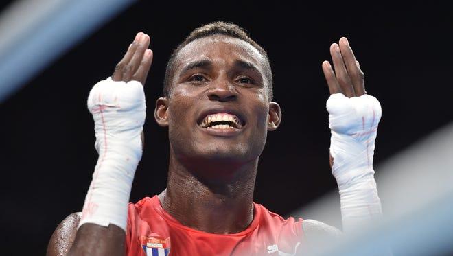 Julio Cesar La Cruz celebrates Cuba's first gold medal in the light heavyweight division since 1980.