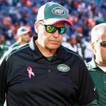 Jets coach Rex Ryan walks off the field following a loss to the Broncos on Sunday. On Tuesday, Ryan said his team has not given up yet, despite its 1-5 record.