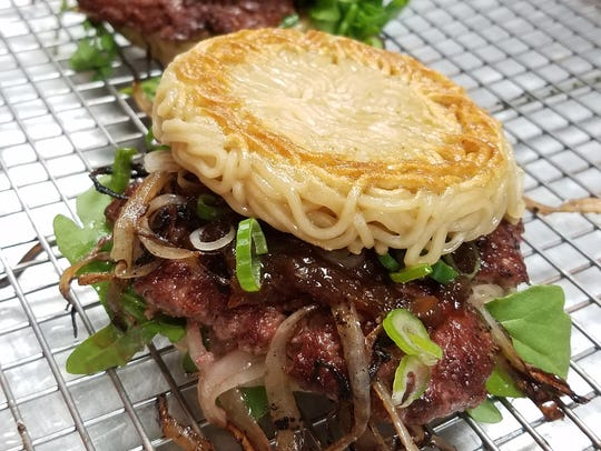 The ramen smashed onion burger is on the menu at Rev