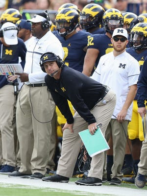 Michigan Wolverines head coach Jim Harbaugh on the sidelines during the first half against the Wisconsin Badgers Saturday, Oct. 1, 2016 at Michigan Stadium in Ann Arbor.