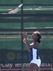 Raven Bennett waited to catch her racquet after a point