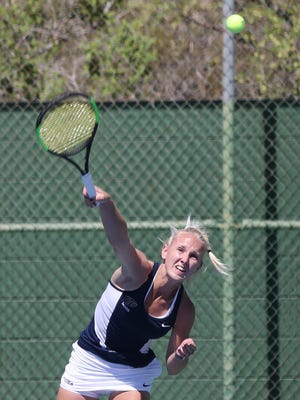 Lois Wagenvoort hits a shot against the Iowa State doubles team Friday.