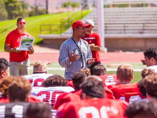 Southern Utah head coach Demario Warren talks to his