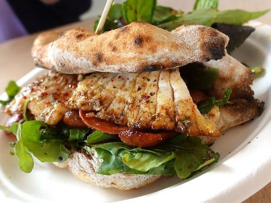 """Pita"" sandwich made with schiacciata, roasted skate"