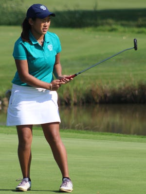 Cranbrook Kingswood captain Katie Cao watches a putt stop  just short of the 16th hole Wednesday in the Division 3 regional.