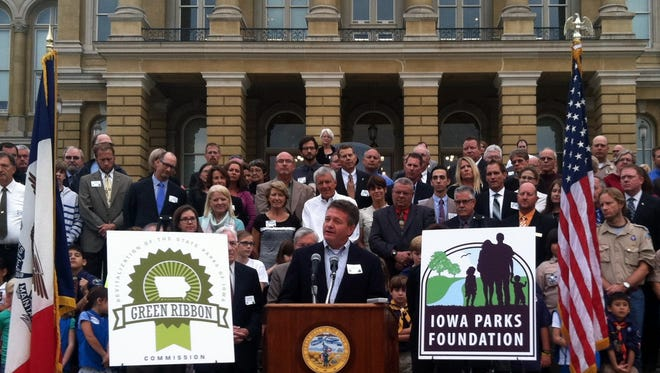 Joe Gunderson, president of the Iowa Parks Foundation, speaks at a news conference Monday outside the Iowa Capitol in Des Moines where the first strategic Iowa parks pilot project was announced.
