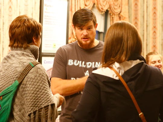 Organizer Nick O'Brien, middle, mingles with patrons in October 2016 during the first Wausau SOUP event at the Wausau Club downtown.