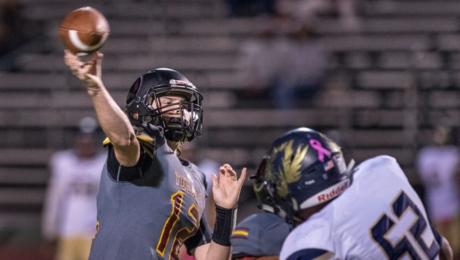 Tulare Union quarterback Nathan Lamb throws against Delano in an East Yosemite League high school football game on Friday, October 13, 2017.