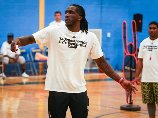 Taurean Prince explains a defensive move during a one-day basketball clinic Saturday, June 9, 2018, at Lincoln Middle School.