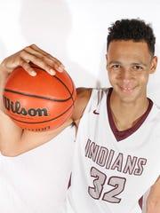 Oskaloosa freshman Xavier Foster, 14, is a 6-foot-9