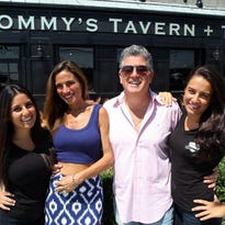 Yvette and Tom Bonfiglio, shown with daughters Christina (left) and Andrea, own Tommy's Tavern + Tap in Sea Bright. On Dec. 2, the family will host a Christmas tree lighting to benefit Toys for Tots
