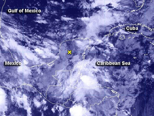System of low pressure moves over the Yucatan Peninsula,