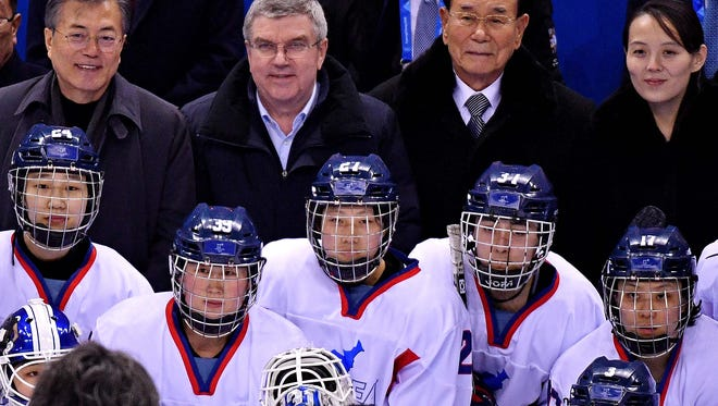 North Korea nominal head of state Kim Yong Nam (right) and other dignitaries with the unified Korean women's Olympic hockey team.
