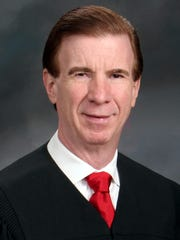 Acting state Supreme Court Justice Thomas Walsh