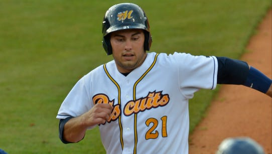 Montgomery Biscuits' Luke Maile (21) beats the throw