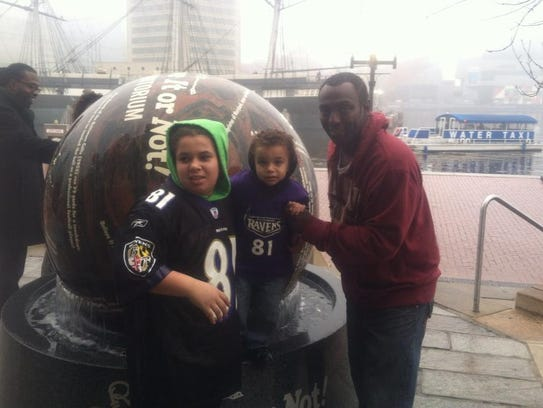 Brandon Cole and his children. Cole was killed in a